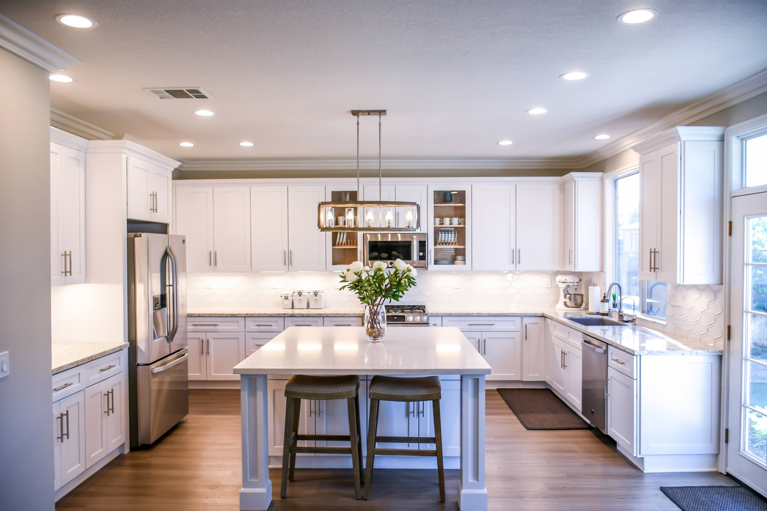 kitchen remodel with white wooden cupboards