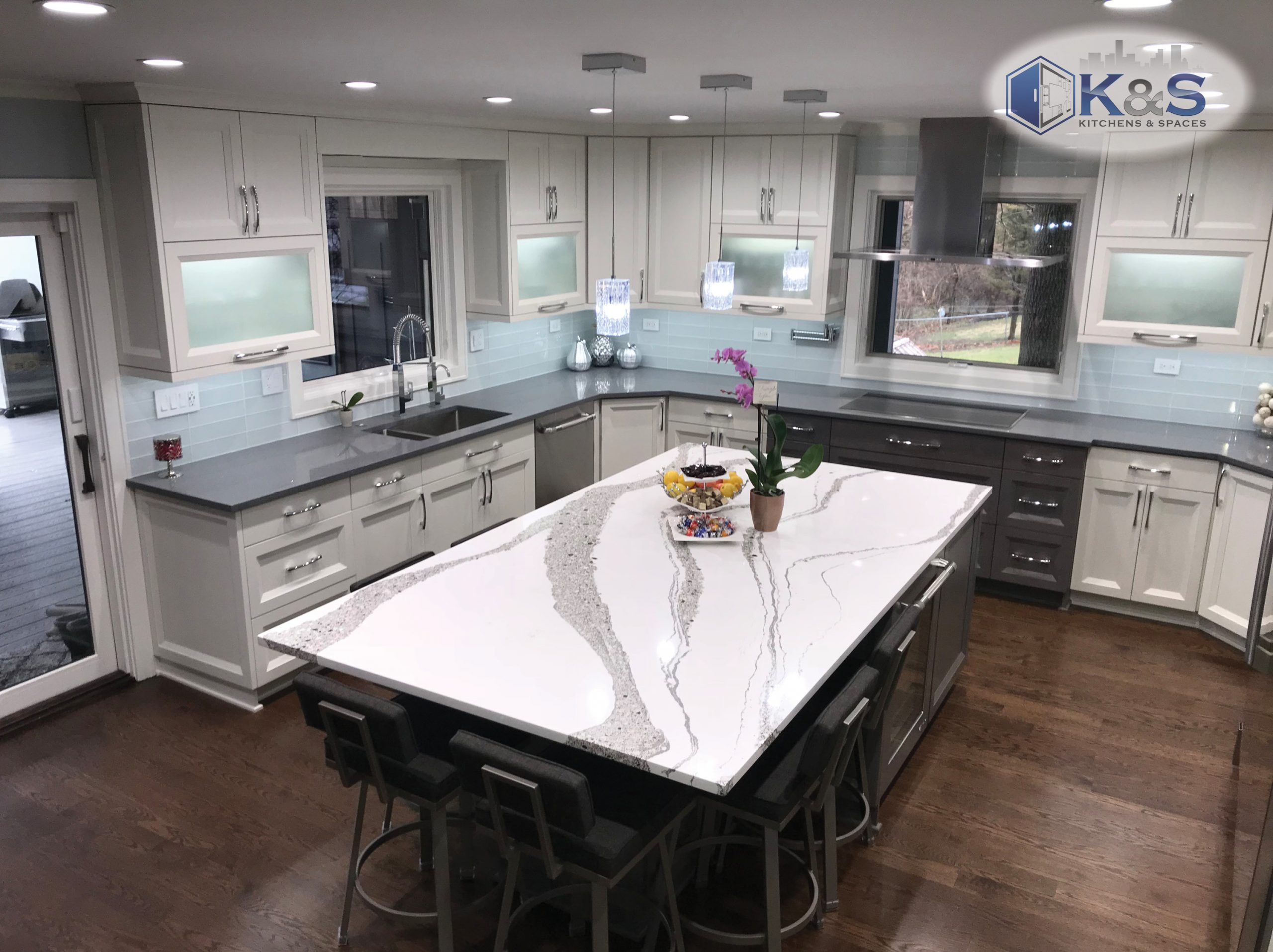 Beautiful kitchen that features custom granite and an open plan